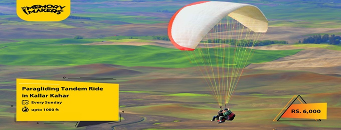 enjoy tandem paragliding in kallar kahar with de memory makers.